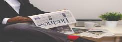 newspaper in black hands